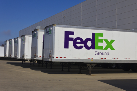 Indianapolis - Circa December 2015: Federal Express Trucks in Loading Docks. FedEx is a global courier delivery services company I