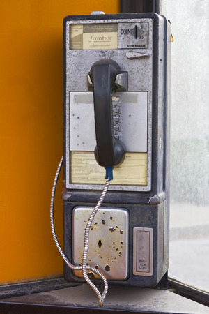 pay phone: Fairmount, IN - Circa December 2015: Vintage Frontier Communications Pay Phone I Editorial