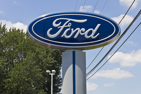 Indianapolis - Circa June 2016: A Local Ford Car and Truck Dealership. Ford is an American  Automaker Headquartered in Michigan II