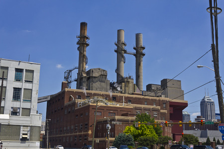 tall chimney: Indianapolis - Circa June 2016: Citizens Energy Group - Perry K. Generating Station in Downtown. Its coal-fired units are currently being converted to natural gas I