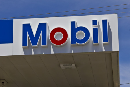 traded: Indianapolis - Circa June 2016: Mobil Gas Station Signage. Mobil Merged with Exxon to Become ExxonMobil Traded as XOM III