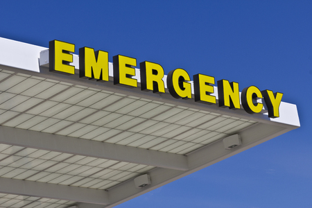 entrance sign: Yellow Emergency Entrance Sign for a Local Hospital VIII Stock Photo