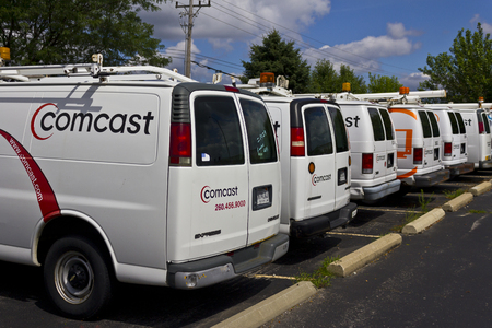 Lafayette, IN - Circa July 2016: Comcast Service Vehicles. Comcast is a Multinational Mass Media Company IV Sajtókép