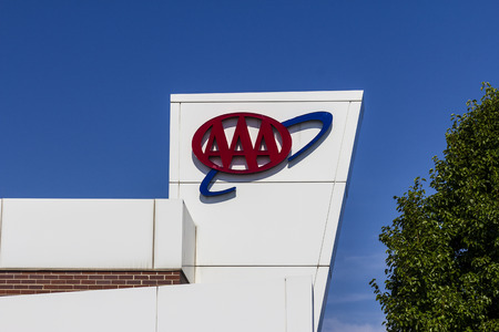 automobiles: Muncie, IN - Circa July 2016: AAA Travel & Insurance Sign. The American Automobile Association Provides Roadside Assistance, Jump Starts and Discounts to its Members I