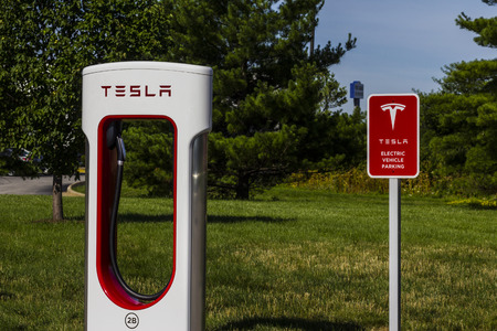 gasoline powered: Lafayette, IN - Circa July 2016: Tesla Supercharger Station. The Supercharger offers fast recharging of the Model S and Model X electric vehicles IX