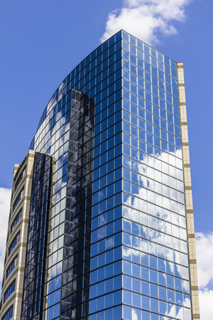 indianapolis: Indianapolis - Circa September 2016: Mirror Tile Window Skyscraper with Blue Sky and White Clouds in Reflection I