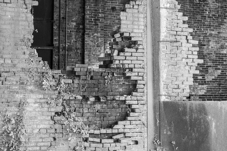 Crumbling Brick Wall of the former Power Plant at the Central Indiana Hospital for the Insane, built in 1886 and abandoned in the 1970s VI Stock Photo