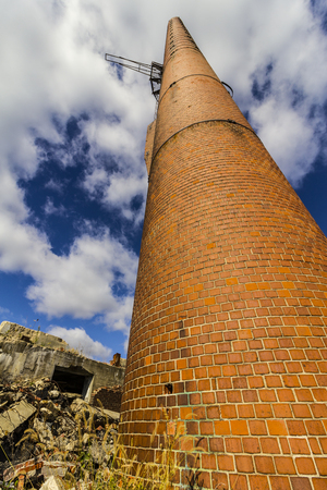 Abandoned Factory with Brick Smokestack and the Remnants of the Power Plant IV Stock Photo