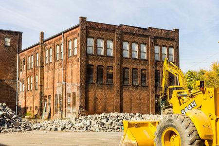 urban decay: Kokomo - Circa October 2016: Former Automotive Warehouse Demolition. Old Rust Belt Factories Make Way for New Construction I