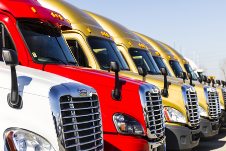 Indianapolis - Circa November 2016: Freightliner Semi Tractor Trailer Trucks Lined up for Sale Editorial