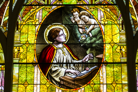 Kokomo - Circa November 2016: Church Stained Glass Portraying Cherubs and Saint Cecilia, the Patron Saint or Patroness of Musicians I