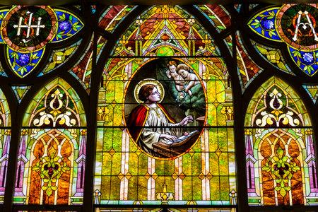 cherubs: Kokomo - Circa November 2016: Church Stained Glass Portraying Cherubs and Saint Cecilia, the Patron Saint or Patroness of Musicians II Editorial