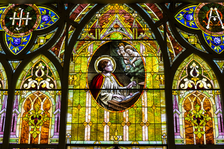 Kokomo - Circa November 2016: Church Stained Glass Portraying Cherubs and Saint Cecilia, the Patron Saint or Patroness of Musicians II Editorial