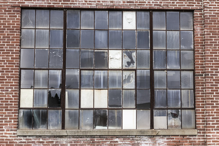 Abandoned School Power Plant with Broken Windows and Crumbling Brick Smokestack I
