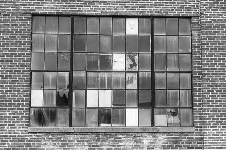 Abandoned School Power Plant with Broken Windows and Crumbling Brick Smokestack II