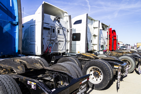 18 wheeler: Indianapolis - Circa February 2017: Colorful Semi Tractor Trailer Trucks Lined up for Sale IV Editorial