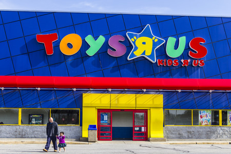 Indianapolis - Circa February 2017: Toys R Us Retail Strip Mall Location. Toys R Us is a Childrens Toy Retailer I