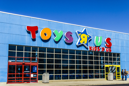 Muncie - Circa March 2017: Toys R Us Retail Strip Mall Location. Toys R Us is a Childrens Toy Retailer III