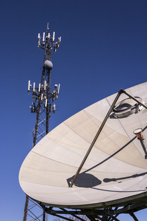 Telecommunications and Wireless Equipment Tower with Directional Mobile Phone Antenna and Satellite Dish V Stock Photo