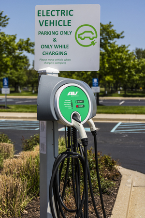 power cables: Fishers - Circa May 2017: Electric Vehicle Charging area. As electric vehicles become more popular, there are many establishments that offer free charging II Editorial