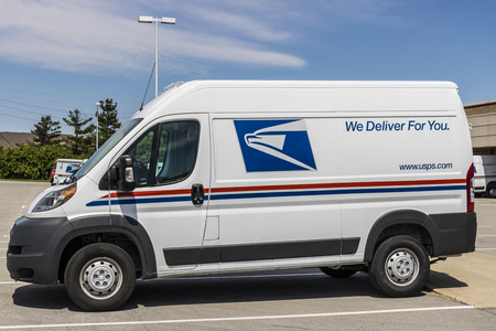 postmaster: Indianapolis - Circa May 2017: USPS Post Office Mail Trucks. The USPS is Responsible for Providing Mail Delivery III