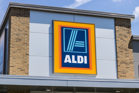 albrecht: Indianapolis - Circa June 2017: Aldi Discount Supermarket. Aldi sells a range of grocery items, including produce, meat & dairy, at discount prices VIII