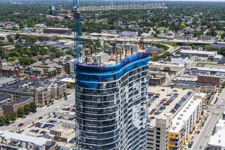 Indianapolis - Circa June 2017: Modern mixed use residential business apartment block skyscraper under construction I