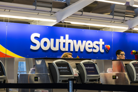 Indianapolis - Circa July 2017: Southwest Airlines Check In desk preparing passengers for departure. Southwest is the largest low-cost carrier in the world III Editorial