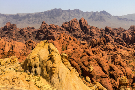 Valley of Fire State Park with 40,000 acres of bright red Aztec sandstone outcrops nestled in gray and tan limestone V
