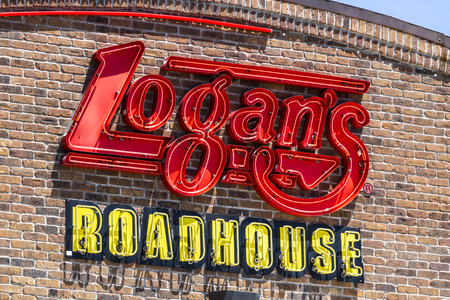 indianapolis: Indianapolis - Circa July 2017: Logans Roadhouse Restaurant and Signage. Logans is a leading casual dining steakhouse I