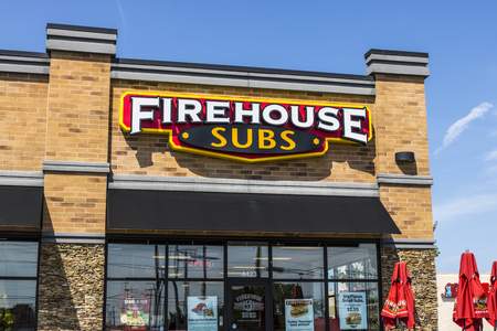 specializes: Ft. Wayne - Circa August 2017: Firehouse Subs fast casual restaurant. Firehouse specializes in hot submarine sandwiches III Editorial