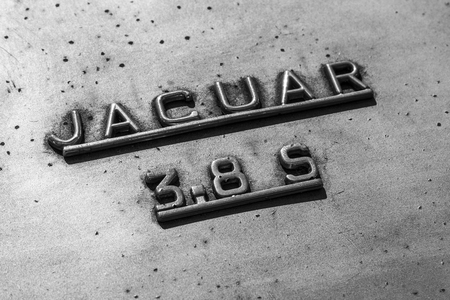 Indianapolis - Circa September 2017: Insignia and emblem from a classic 60s Jaguar 3.8 S II Editorial