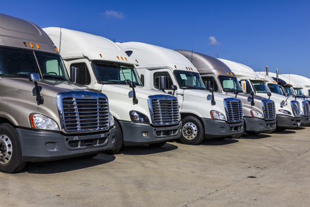 Indianapolis - Circa September 2017: Colorful Semi Tractor Trailer Trucks Lined up for Sale XIX