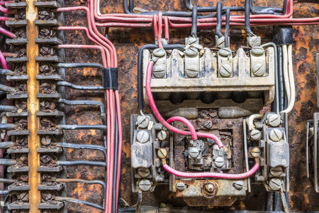 Old Rusted Electrical Panel with Fuses and Contacts in an Abandoned Automobile Factory IV Stock Photo