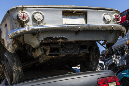 Indianapolis - Circa September 2017: Stacked junk yard Corvair prepared for crushing to be recycled II