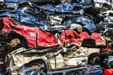 Indianapolis - Circa September 2017: Stacked junk yard clunker cars prepared for crushing to be recycled IX Editorial