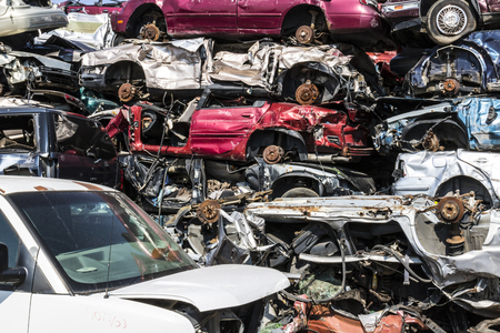 Indianapolis - Circa September 2017: Stacked junk yard clunker cars prepared for crushing to be recycled X