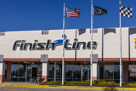 Indianapolis - Circa October 2017: Finish Line, Inc. Retail Strip Mall Location with the US, Indiana and Checkered Flags. Finish Line is a retailer offering footwear and accessories III