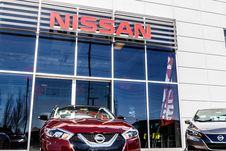Indianapolis - Circa March 2018: Logo and Signage of a Nissan Car and SUV Dealership. Nissan is part of the Renault–Nissan Alliance I