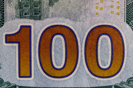 Closeup of the 100 on the reverse of a one hundred dollar bill for background III Stock Photo