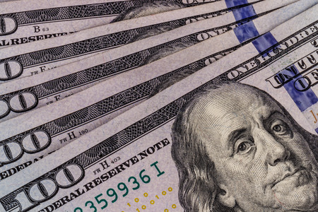 Closeup of Ben Franklin on a one hundred dollar bill for background VIII