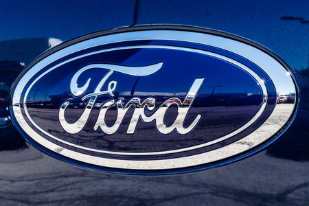 Fishers - Circa March 2018: Ford Oval tailgate logo on an F150 pickup truck. Ford sells products under the Lincoln and Motorcraft brands IV