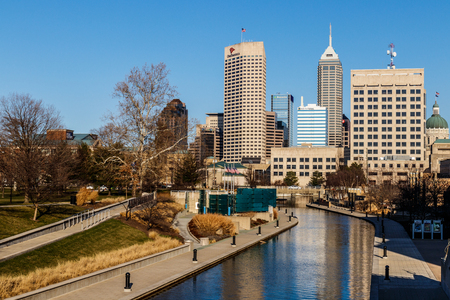Indianapolis - Circa March 2018: Indy Downtown Skyline on a Sunny Day with the newly renamed Salesforce Tower and State Capitol from the Canal Walk VIII Stock Photo - 98155096