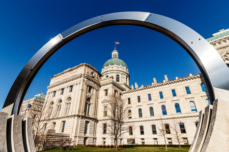 Indianapolis - Circa March 2018: Dale Enochs Time Flow framing the Indiana State House. Part of the Indiana State House Public Art Collection I Editorial