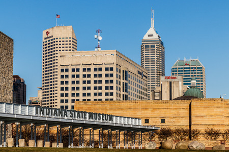 Indianapolis - Circa March 2018: Indianapolis Downtown Skyline with the Indiana State Museum on a Sunny Day VI Editorial