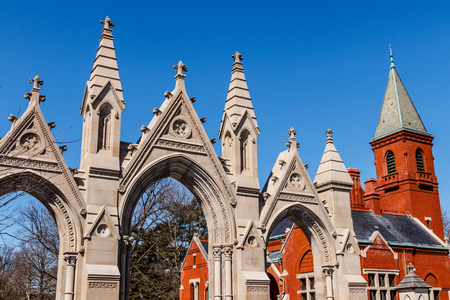 Indianapolis - Circa March 2018: Gothic architecture of the Crown Hill Cemetery. A Historic Landmark of Indiana, the triple-arched stone gate was completed in 1885 I