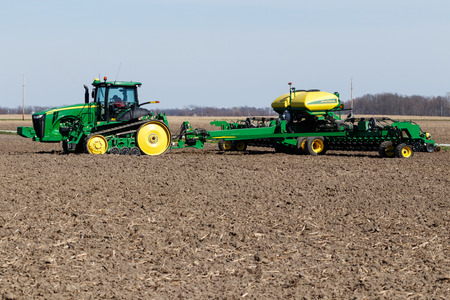 Point Isabel - Circa April 2018: John Deere 8335 RT and CCS Seed Delivery tractors. Deere manufactures agricultural, construction, and forestry machinery II Editorial