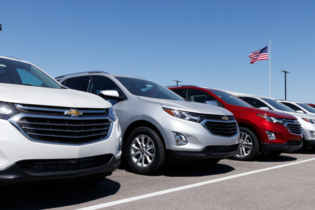 Lafayette - Circa April 2018: Chevrolet Automobile Dealership with American flag. Chevy is a Division of General Motors Editorial