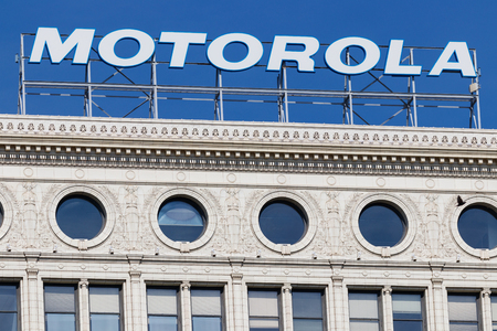 Chicago - Circa May 2018: Motorola Solutions logo atop the Railway Exchange Building. Motorola provides communications solutions for law enforcement and utility workers I