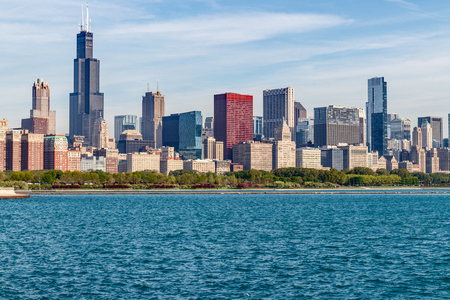 Chicago - Circa May 2018: Windy City downtown skyline from Lake Michigan on a sunny day. Chicago is home to the Cubs, Bears, Blackhawks and deep dish pizza I Editorial